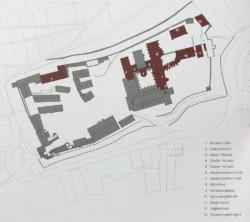 Lageplan; dunkel markiert die sanierten und umgebauten Gebäude